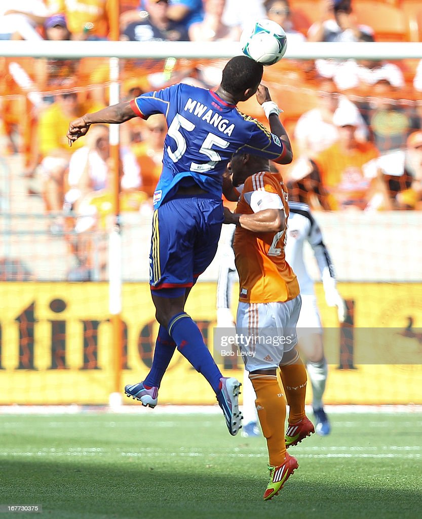 Danny Mwanga #55 of the Colorado Rapids heads the ball away from Corey Ashe #26 of the Houston Dynamo at BBVA Compass Stadium on April 28, 2013 in Houston, Texas.