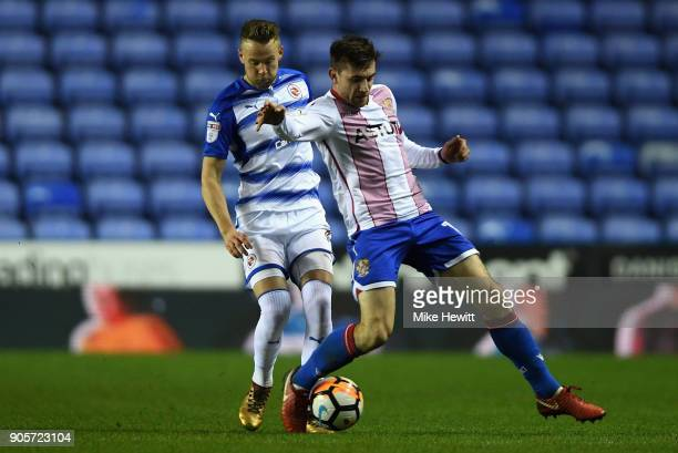 Danny Newton of Stevenage holds off Chris Gunter of Reading during The Emirates FA Cup Third Round Replay match between Reading and Stevenage at...