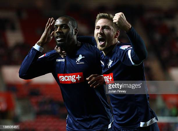 Danny N'Guessan of Millwall celebrates scoring with team mate James Henry of Millwall during the FA Cup Fourth Round Replay match between Southampton...