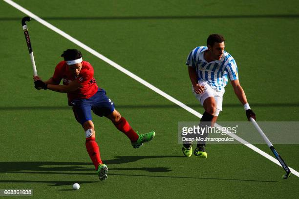 Danny Nguyen of Mannheimer HC shoots on goal in front of Ignasi Use of Club Egara during the Euro Hockey League KO16 match between Mannheimer HC and...