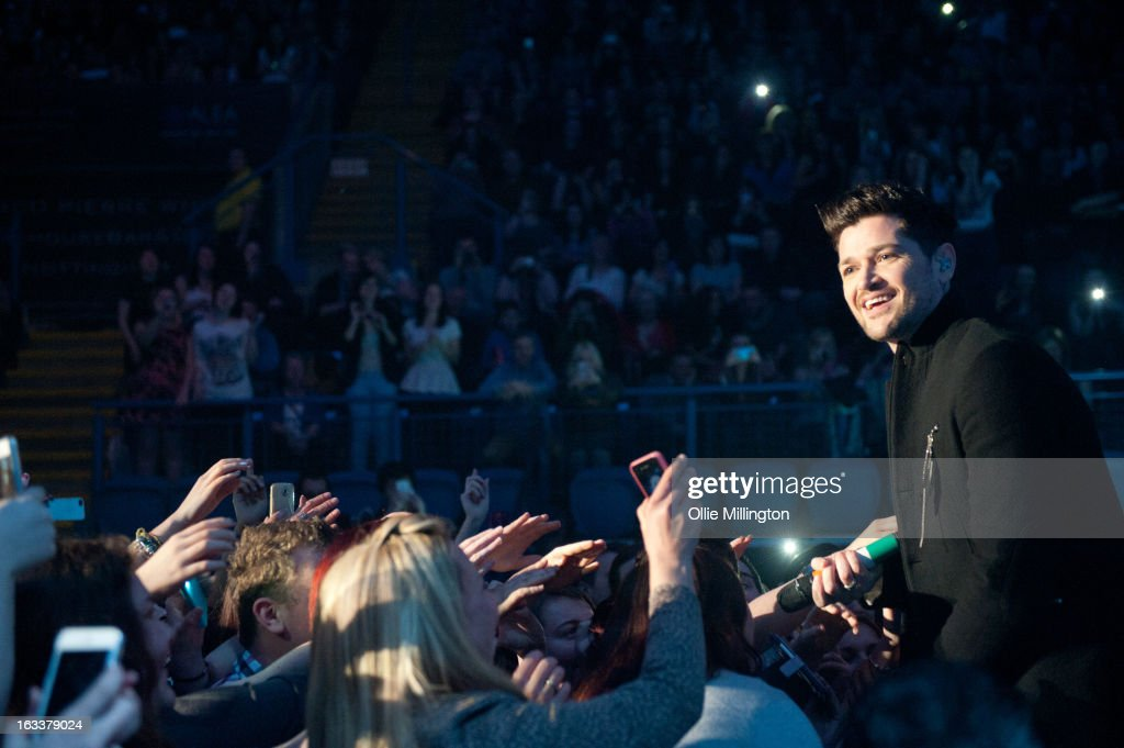 Danny O'Donoghue of The Script performs infront of the stage in concert on the opening night of the bands March 2013 UK Tour during the #3 World Tour at Nottingham Capital FM Arena on March 8, 2013 in Nottingham, England.