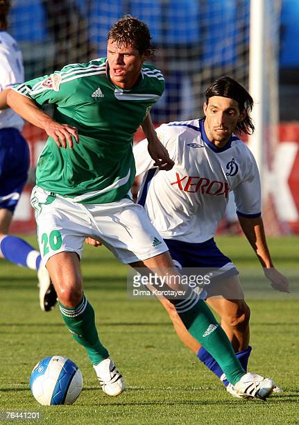 Danny of FC Dynamo Moscow competes for the ball with Dmitri Tarasov of FC Tom Tomsk during the Russian Football League Championship match between FC...