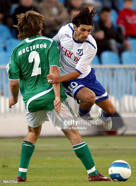 Danny of FC Dynamo Moscow competes for the ball with Ruslan Mostovoy of FC Tom Tomsk during the Russian Football League Championship match between FC...