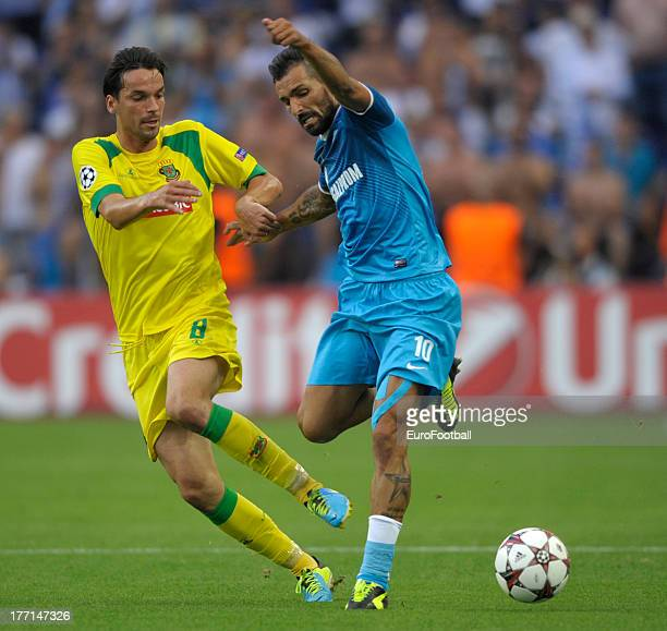 Danny of FC Zenit St Petersburg is challenged by Andre Leao of FC Pacos de Ferreira during the UEFA Champions League playoff first leg match between...