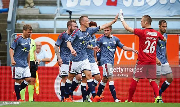 Danny Olsen of AGF Aarhus and Goalkeeper Aleksandar Jovanovic of AGF Aarhus celebrate after scoring their first goal during the Danish Alka Superliga...