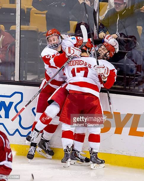 Danny O'Regan of the Boston University Terriers celebrates his double overtime goal with teammates Jack Eichel and Evan Rodrigues giving the Terriers...