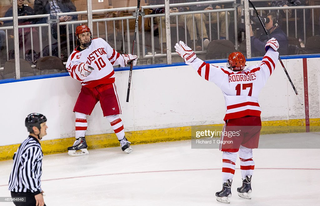 Danny O'Regan #10 of the Boston University Terriers celebrates his overtime winning goal against the Yale Bulldogs during the NCAA Division I Men's Ice Hockey Northeast Regional Championship Semifinal at the Verizon Wireless Arena on March 27, 2015 in Manchester, New Hampshire. The Terriers won 3-2 in overtime.