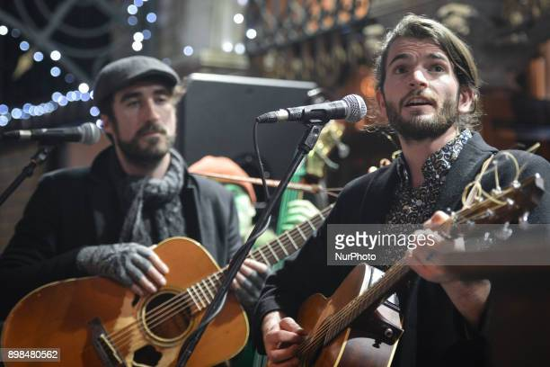 Danny O'Reilly from the Coronas and Harry Hudson Taylor perform together during the annual Christmas Eve busk in aid of the Dublin Simon Community...
