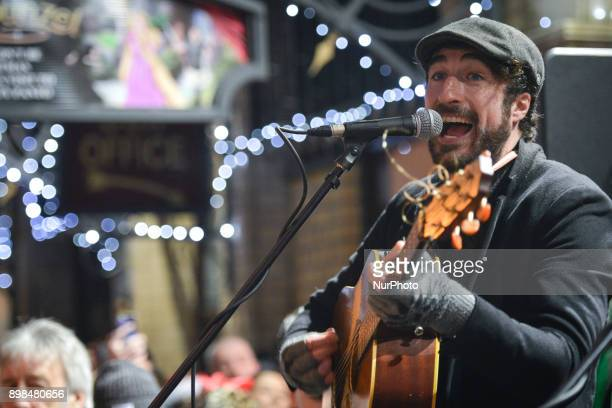 Danny O'Reilly from the Coronas takes part in the annual Christmas Eve busk in aid of the Dublin Simon Community outside the Gaiety Theater in Dublin...