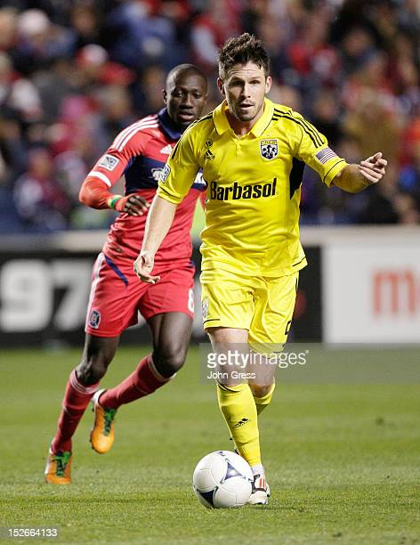 Danny O'Rourke of the Columbus Crew advances the ball on Dominic Oduro of the Chicago Fire during their MLS soccer match at Toyota Park on September...