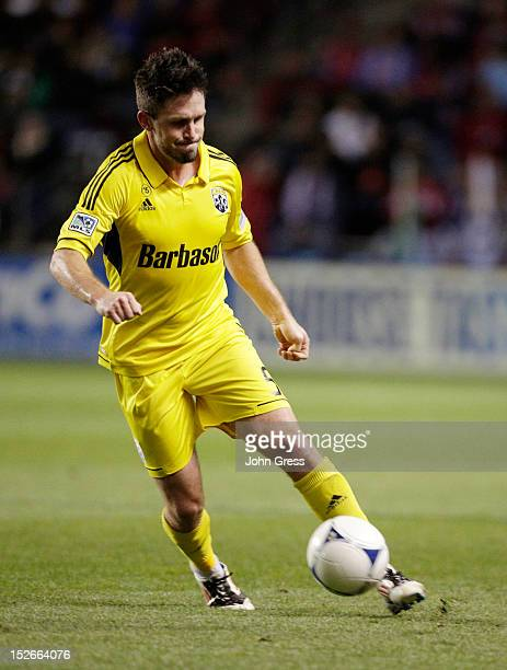 Danny O'Rourke of the Columbus Crew advances the ball on the Chicago Fire during their MLS soccer match at Toyota Park on September 22 2012 in...