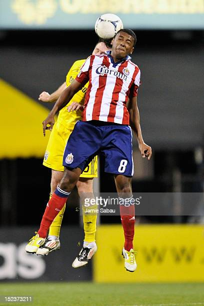 Danny O'Rourke of the Columbus Crew and Oswaldo Minda of Chivas USA battle for control of the ball in the second half on September 19 2012 at Crew...