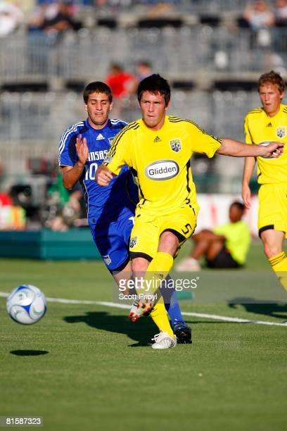 Danny O'Rourke of the Columbus Crew passes the ball against the Kansas City Wizards during the game at Community America Ballpark on June 14 2008 in...