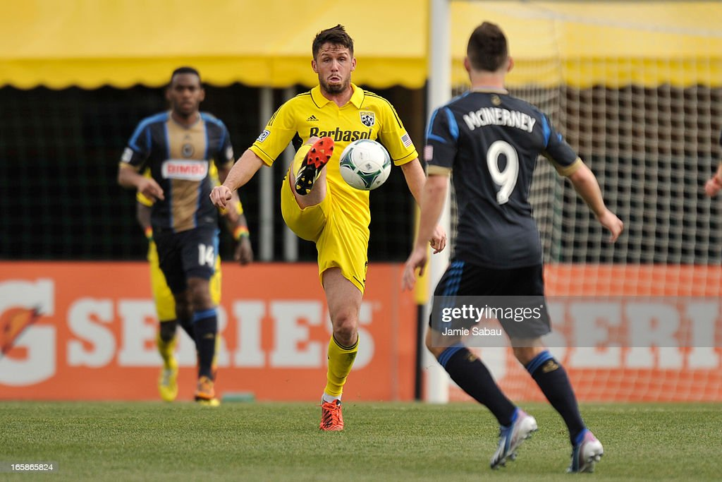 Danny O'Rourke #5 of the Columbus Crew takes control of the ball in the first half as Jack McInerney #9 of Philadelphia Union watches on April 6, 2013 at Crew Stadium in Columbus, Ohio. Columbus and Philadelphia played to a 1-1 tie.