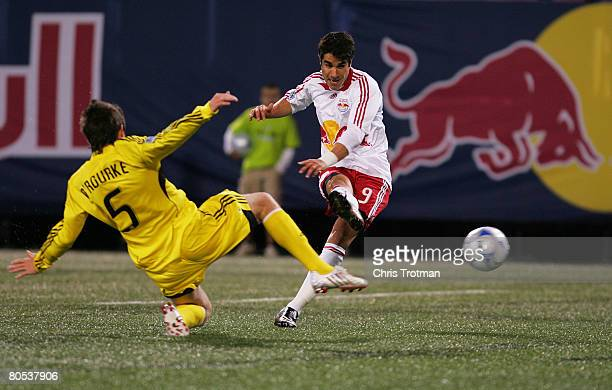 Danny O'Rourke of the Columbus Crew tries to block Juan Pablo Angel of the New York Red Bulls shot at Giants Stadium in the Meadowlands on April 5...