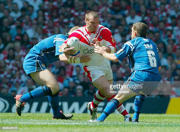 Danny Orr of Wigan Warriors tries to tackle Kieron Cunningham of St Helens during the Powergen Challenge Cup Final match between St Helens and Wigan...