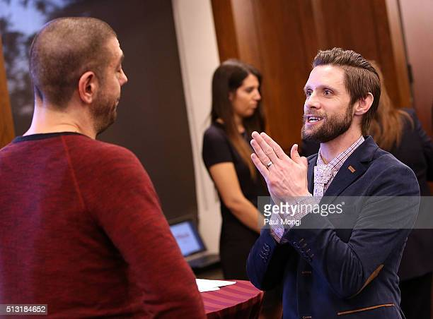 Danny Pintauro talks with a guest at the AIDSWatch 2016 Positive Leadership Award Reception at the Rayburn House Office Building on February 29 2016...
