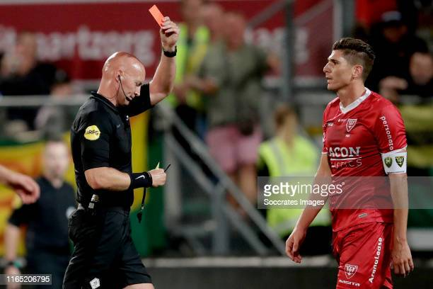 Danny Post of VVV Venlo receives a red card from referee Siemen Mulder during the Dutch Eredivisie match between ADO Den Haag v VVVVenlo at the Cars...