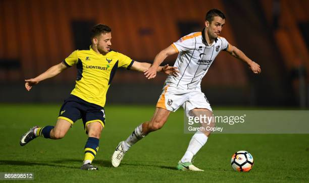 Danny Pugh of Port Vale gets past Jack Payne of Oxford during The Emirates FA Cup First Round match between Port Vale and Oxford United at Vale Park...
