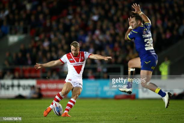 Danny Richardson of St Helens takes a drop kick to level scores during the BetFred Super League semi final match between St Helens and Warrington...