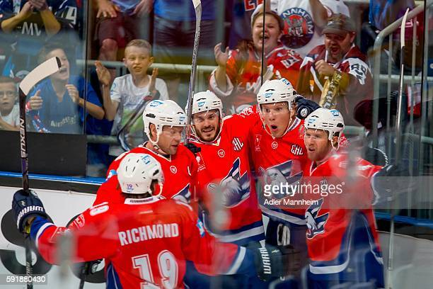 Danny Richmond Aaron Johnson Chad Kolarik David Wolf and Garrett Festerling of Adler celebrate 10 during the Champions Hockey League match between...