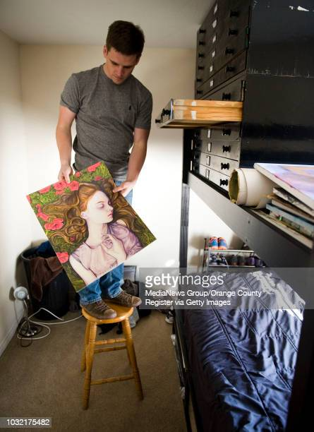Danny Roberts goes through some of his art work stacked above his bed at his parents' Laguna Niguel home. ///ADDITIONAL INFO: fashion.danny.01xx.kjs...