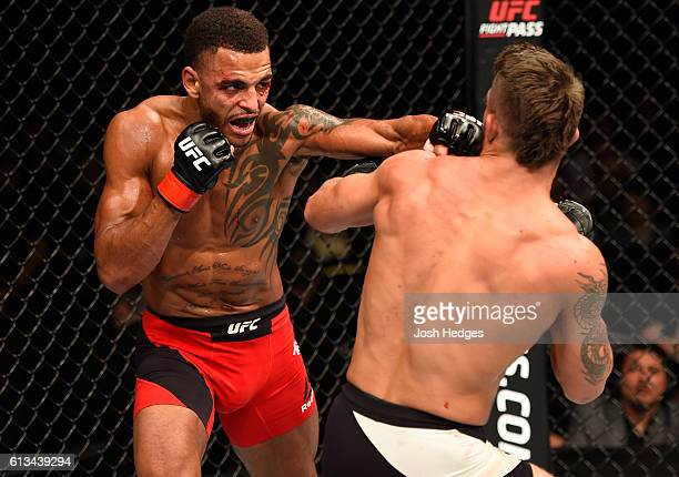 Danny Roberts of England punches Mike Perry in their welterweight bout during the UFC 204 Fight Night at the Manchester Evening News Arena on October...
