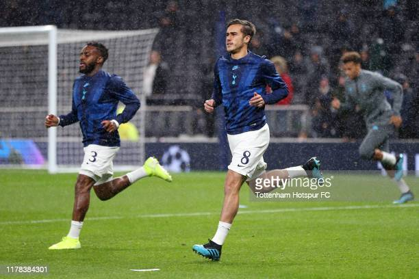 Danny Rose and Harry Winks of Tottenham Hotspur warm up prior to the UEFA Champions League group B match between Tottenham Hotspur and Bayern...