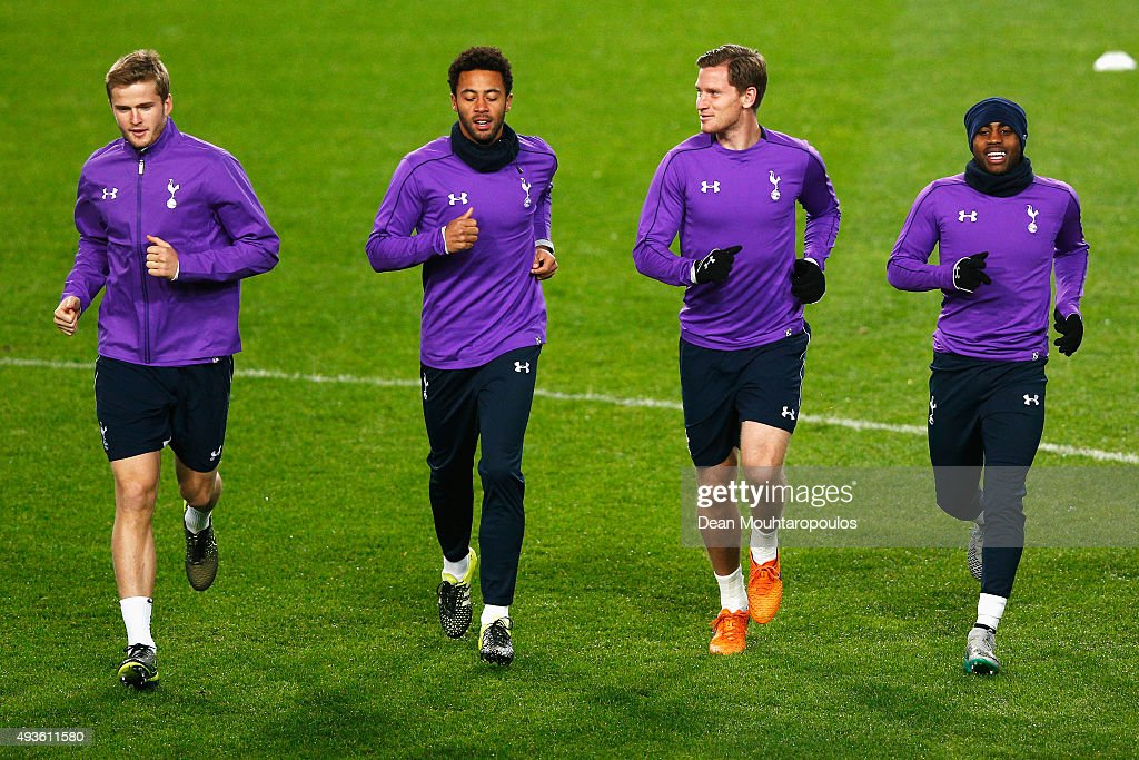 Danny Rose, Jan Vertonghen, Mousa Dembele and Eric Dier warm up during the Tottenham Hotspur training session ahead of the UEFA Europa League match against Anderlecht at Constant Vanden Stock Stadium on October 21, 2015 in Brussels, Belgium.