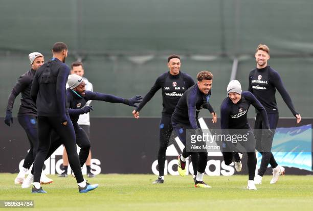 Danny Rose of England and Dele Alli of England chase Jamie Vardy of England in a drill during the England training session at the Stadium Spartak...