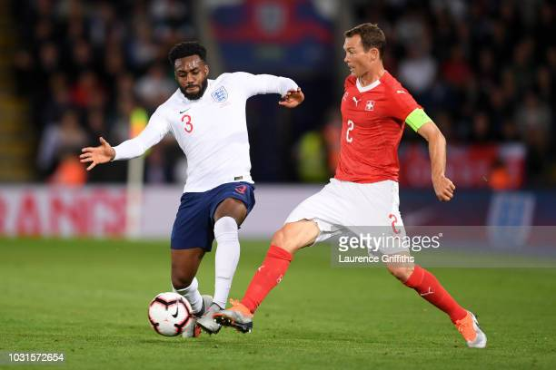 Danny Rose of England battles with Stephan Lichtsteiner of Switzerland during the international friendly match between England and Switzerland at The...