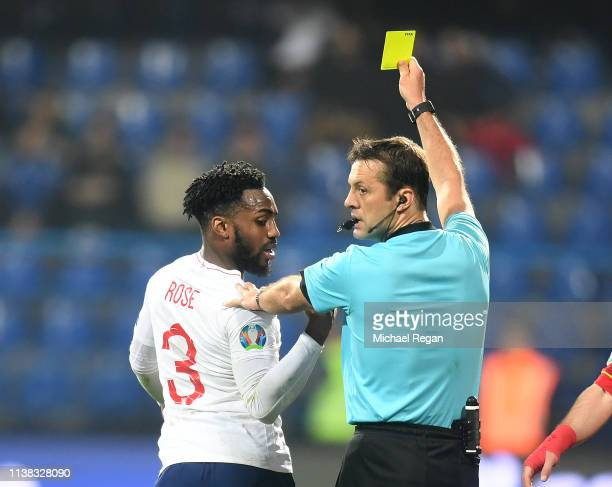 Danny Rose of England is booked during the 2020 UEFA European Championships group A qualifying match between Montenegro and England at Podgorica City...