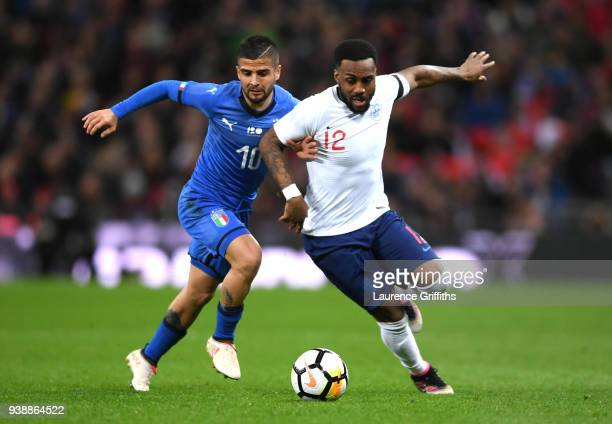 Danny Rose of England is challenged by Lorenzo Insigne of Italy during the International friendly between England and Italy at Wembley Stadium on...