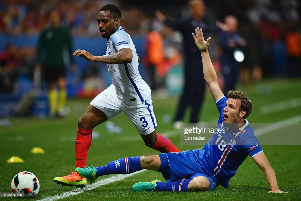Danny Rose of England is tackled by Elmar Bjarnason of Iceland during the UEFA EURO 2016 round of 16 match between England and Iceland at Allianz Riviera Stadium on June 27, 2016 in Nice, France.