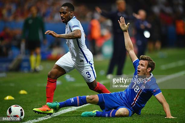 Danny Rose of England is tackled by Elmar Bjarnason of Iceland during the UEFA EURO 2016 round of 16 match between England and Iceland at Allianz...