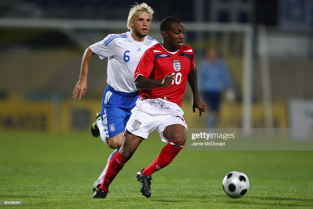 Danny Rose of England (R) runs with the ball during the UEFA U21 Championship match between Greece and England at the Asteras Tripolis Stadium on September 8, 2009 in Tripolis, Greece.