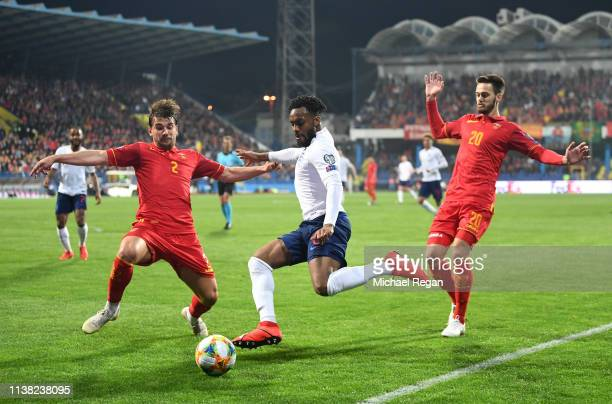 Danny Rose of England takes on Filip Stojkovic and Mirko Ivanic of Montenegro during the 2020 UEFA European Championships Group A qualifying match...