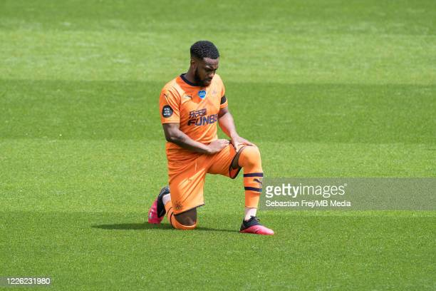 Danny Rose of Newcastle United take a knee during the Premier League match between Watford FC and Newcastle United at Vicarage Road on July 11 2020...