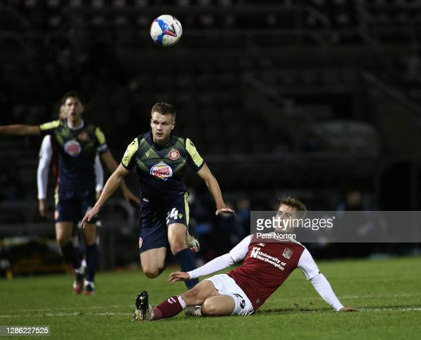 Danny Rose of Northampton Town attempts a shot at goal watched by Ross Marshall of Stevenage during the Papa John's Trophy match between Northampton...