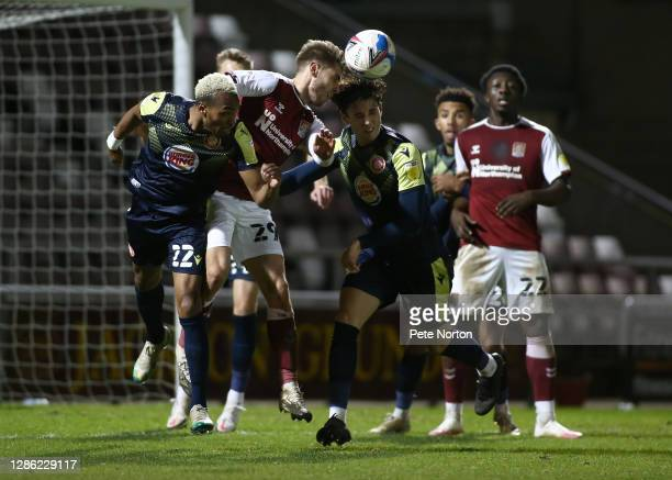 Danny Rose of Northampton Town contests the ball with Marcus Dinanga and Arthur Iontton of Stevenage during the Papa John's Trophy match between...