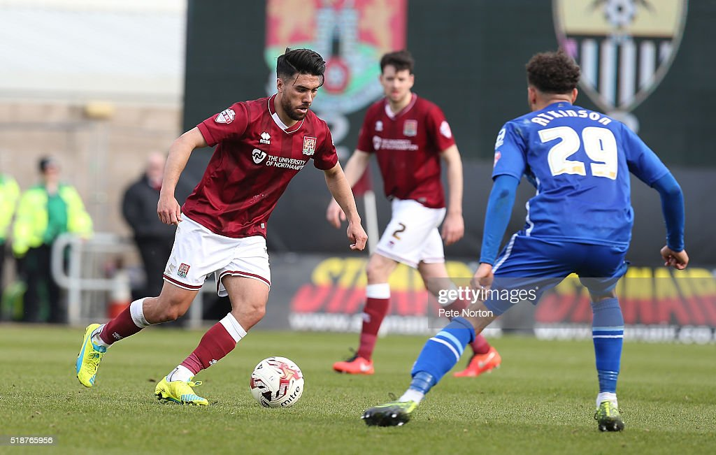 Danny Rose of Northampton Town moves forward with the ball watched by Wes Atkinson of Notts County during the Sky Bet League Two match between Northampton Town and Notts County at Sixfields Stadium on April 2, 2016 in Northampton, England.