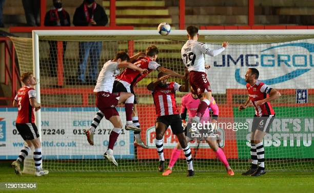 Danny Rose of Northampton Town scores his side's first goal during the EFL Trophy match between Exeter City and Northampton Town at St James Park on...