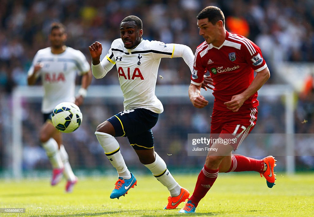 Danny Rose of Spurs and Graham Dorrans of West Brom chase down the ball during the Barclays Premier League match between Tottenham Hotspur and West Bromwich Albion at White Hart Lane on September 21, 2014 in London, England.