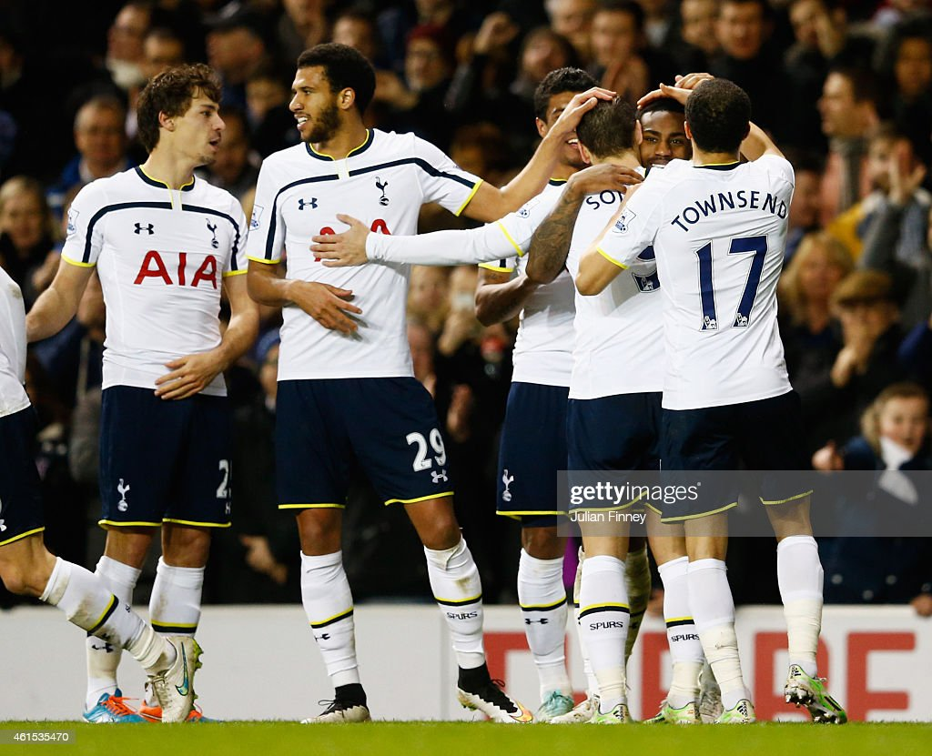 Danny Rose of Spurs (2R) celebrates with team mates as he scores their fourth goal during the FA Cup Third Round Replay match between Tottenham Hotspur and Burnley at White Hart Lane on January 14, 2015 in London, England.