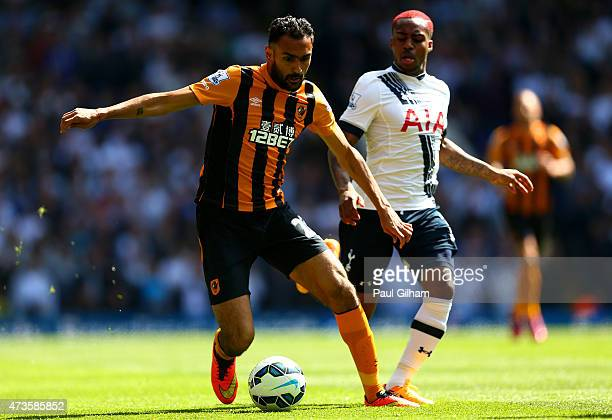 Danny Rose of Spurs closes down Ahmed Elmohamady of Hull City during the Barclays Premier League match between Tottenham Hotspur and Hull City at...