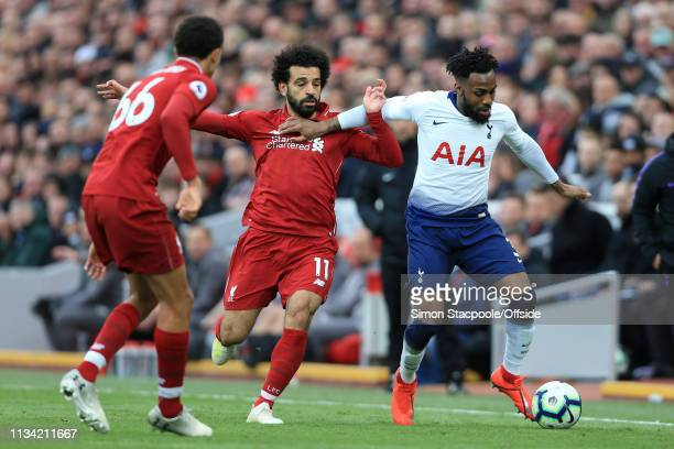 Danny Rose of Spurs holds off Mohamed Salah of Liverpool during the Premier League match between Liverpool and Tottenham Hotspur at Anfield on March...