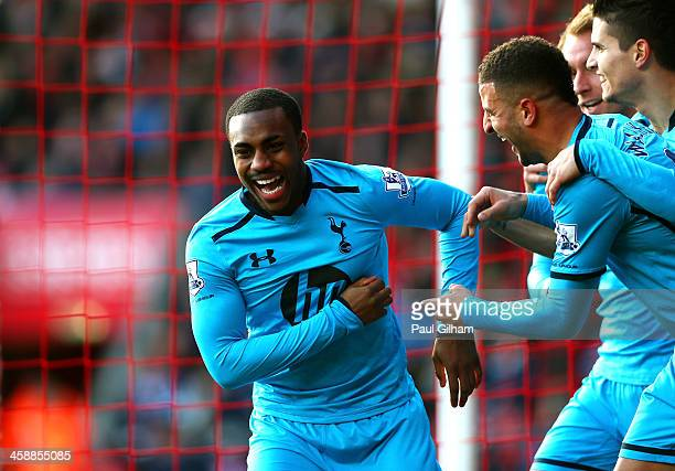 Danny Rose of Spurs is congratulated by teammates after his cross lead to an own goal by Jos Hooiveld of Southampton during the Barclays Premier...