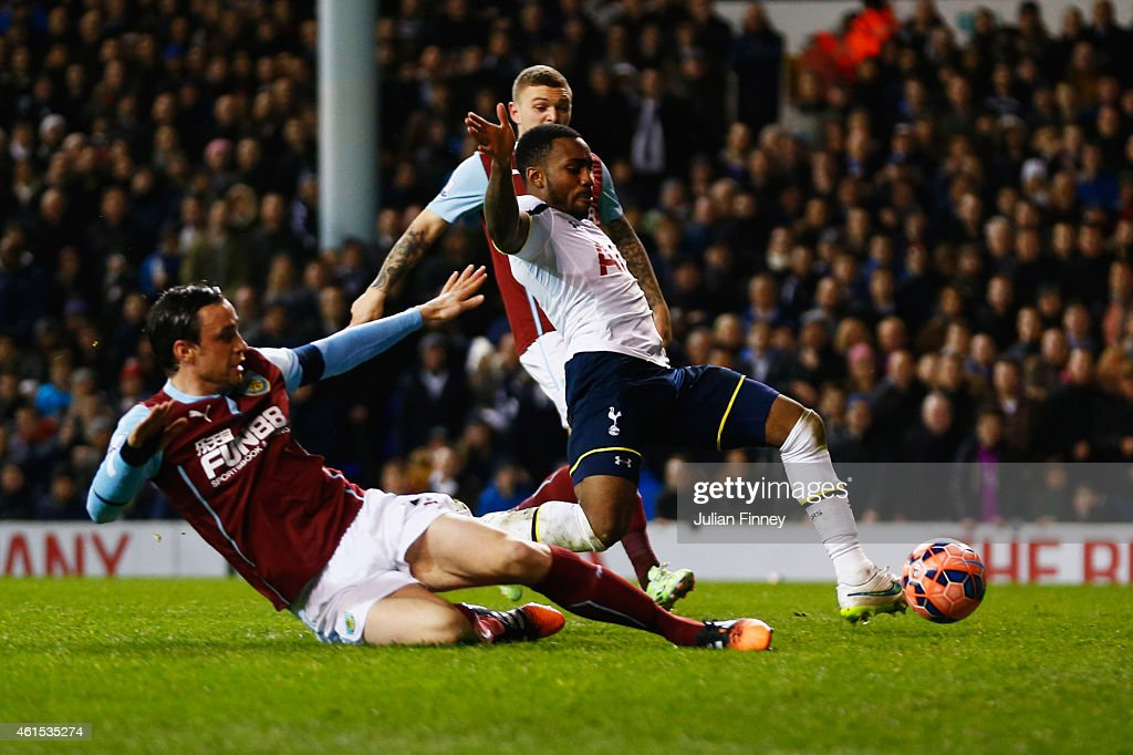 Danny Rose of Spurs (R) scores their fourth goal during the FA Cup Third Round Replay match between Tottenham Hotspur and Burnley at White Hart Lane on January 14, 2015 in London, England.