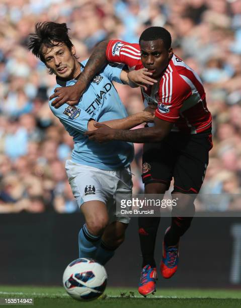 Danny Rose of Sunderland tangles with David Silva of Manchester City during the Barclays Premier League match between Manchester City and Sunderland...