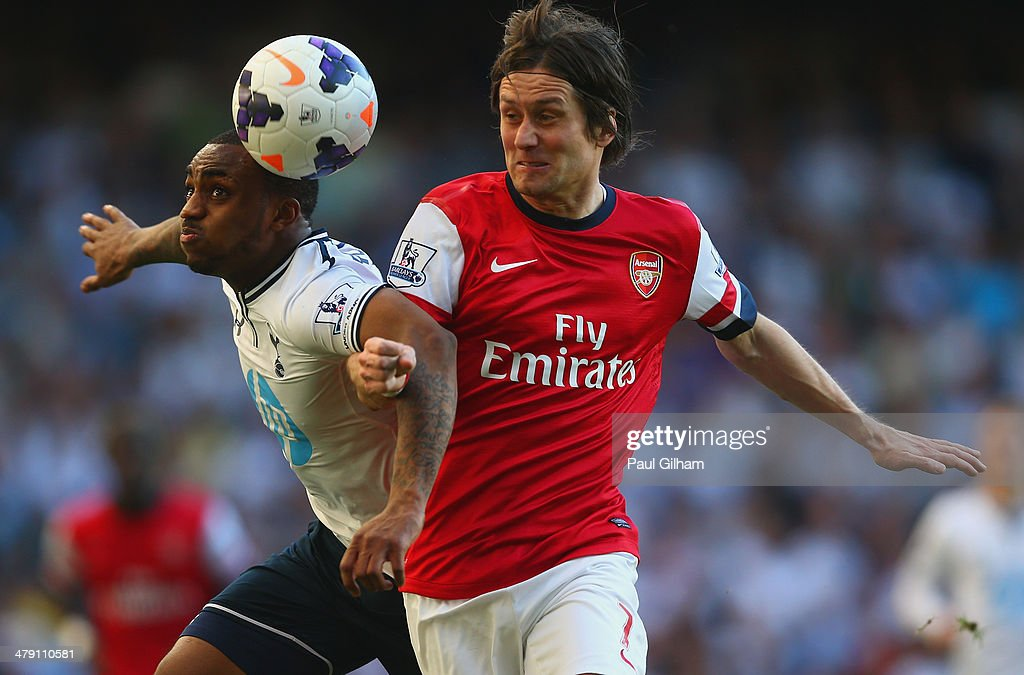 Danny Rose of Tottenham Hotspur and Tomas Rosicky of Arsenal battle for the ball during the Barclays Premier League match between Tottenham Hotspur and Arsenal at White Hart Lane on March 16, 2014 in London, England.